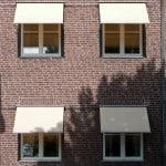 Fallarmsmarkiser för fönster